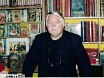 Michel Deligne dans sa librairie pris en photo par Jean-Jacques Procureur.