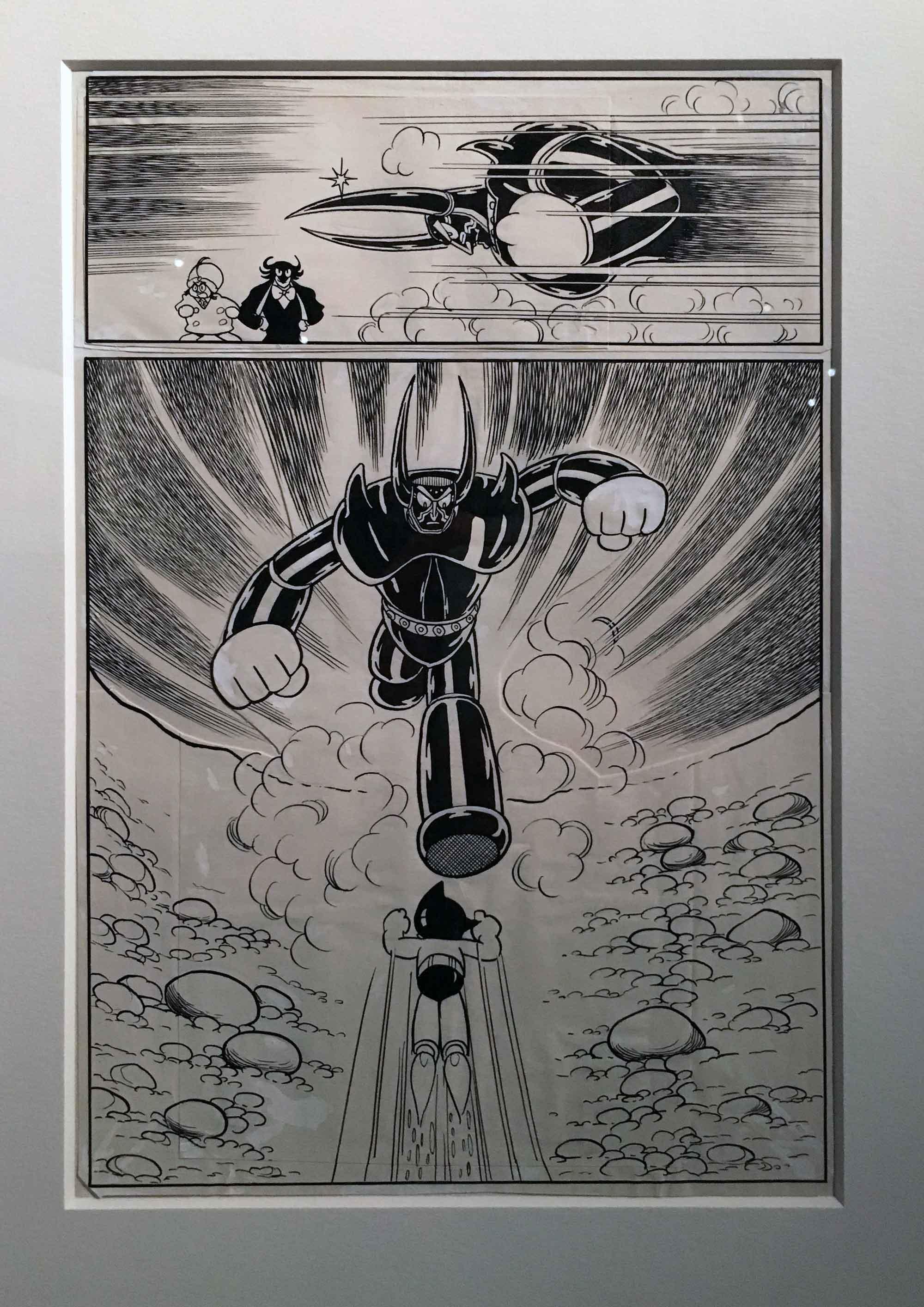 Le lien entre l'exposition de Tezuka et celle de Naoki Urasawa s'est fait par le biais de deux planches montrant un extrait de l'épisode «Le robot le plus fort du monde» qui a inspiré Urasawa pour sa série «Pluto». Un bel hommage avec ces documents rare qui relie les deux hommes au sein d'un même festival.